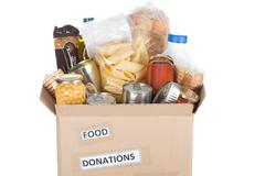 Box of food to donate - stock photo
