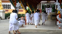 Thai people and children ordain as a nun and Brahmin for practice the dharma Stock Footage