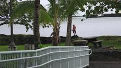 Skateboarder wishing for a surfboard Hawaii Stock Footage