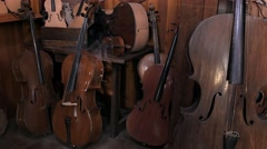 Shop craftsman luthier, ancient group of cellos Stock Footage