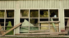 Wall and windows of the abandoned house. Autumn daytime. Smooth dolly shot. - stock footage
