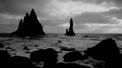 Iceland Gothic island and sea stacks on the coast with waves and dramatic sky - stock footage