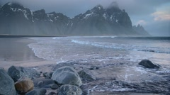 Volcanic beach and mountains with crashing waves in winter, Iceland Stock Footage