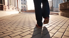Man walking on sidewalk. closeup foot Stock Footage