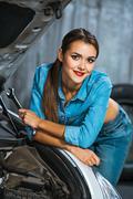 Concept for young sexy female car repair Stock Photos