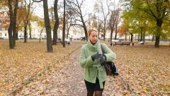 Woman quickly go and check time, look to wristwatch, slow down and pass Stock Footage
