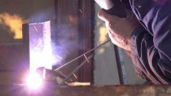 Slider shot of shielded metal arc welding in metal workshop Stock Footage