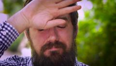 Portrait of a bearded man showing stress and relief Stock Footage