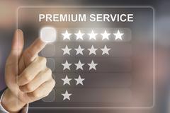 Business hand pushing premium service on virtual screen Stock Photos
