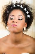 Portrait of beautiful exotic emotional bride looking grumpy - stock photo
