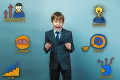 boy businessman opened his mouth, ready for battle cries clenche - stock photo