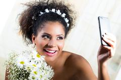 Portrait of beautiful exotic emotional bride taking a selfie Stock Photos