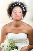 Portrait of beautiful exotic emotional bride looking bored Stock Photos