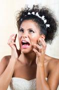 Portrait of beautiful exotic emotional bride screaming Stock Photos