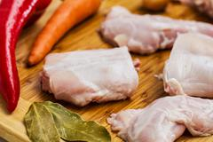 Raw rabbit with black pepper and allspice - stock photo