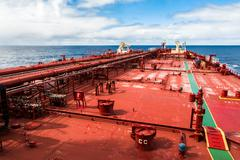 Red deck of a crude oil products tanker. - stock photo