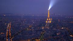 Paris, aerial view of the Eiffel tower at night Stock Footage