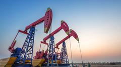 Oilfield with pump units Stock Photos