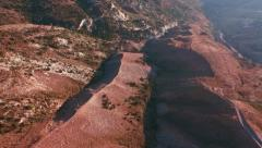 AERIAL: Flying over the countryside PAN near Kathikas, Cyprus Stock Footage