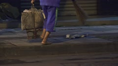 Lady Cleaning The Sidewalk With Broom At Night Chengdu China Stock Footage