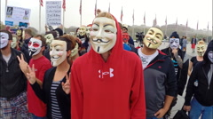 Protesters from the group Anonymous prepare for the Million Mask March  - stock footage