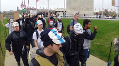 Protesters from the group Anonymous  walk during the Million Mask March - stock footage