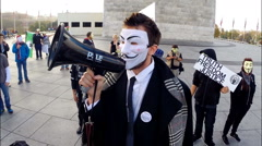 An angry protester from Anonymous speaks at the Million Mask March - stock footage
