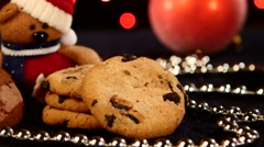 Christmas tree, cookies with decoration, pine cone on black, beads, bokeh, light - stock footage