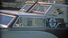 1964: Recreational boat heading out of harbor into the sunny waters. Stock Footage