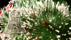 Decoration - a toy silver bell on christmas tree, bokeh, light, black, garland - stock footage