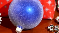 Gift boxes, christmas and new year toys, balls, cam moves to the left, close up Stock Footage