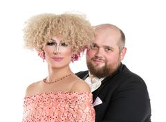 Eccentric Fat Man in a Tuxedo and Beautiful Lady in an Evening Dress - stock photo