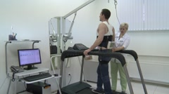 The patient is undergoing tests on a treadmill. Stock Footage