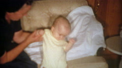 1964: Mom propping up baby's head from falling forward. Stock Footage