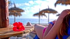 Woman sunbathing on the beach Stock Footage