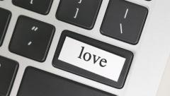 4K Pressing LOVE Button On Computer Keyboard - stock footage