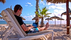 Finish work on laptop and walk on sand beach Stock Footage