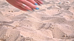 Grabbing sandy beach in palms close up Stock Footage