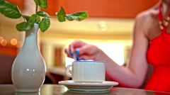 Coffee cup and flower pot on table Stock Footage