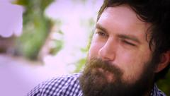 Portrait of a bearded man very depressed and sad Stock Footage