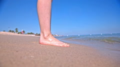 Person legs stand next to sea with water splashing Stock Footage