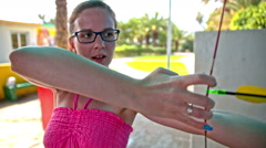 Woman training shooting with bow and arrow - stock footage