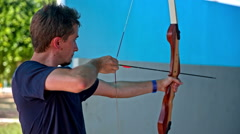 Man first time shooting with bow and arrow - stock footage