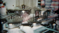 1964: Wedding gifts laid out on the table of kitchen and domestic home goods. Stock Footage