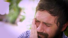 Portrait of a bearded man severely depressed and sad Stock Footage