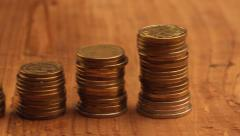 Stacked coins slider shot Stock Footage
