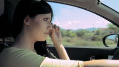 Heartbroken woman crying after breakup driving car Stock Footage