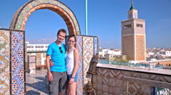 Couple posing with Tunis town in background Stock Footage