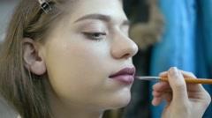 Make Up Artist And Beautiful Model Brunette On Set - stock footage