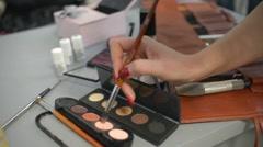 Make-Up Artist Taking Eye Shadows From Makeup Eyeshadows Palette. Stock Footage
